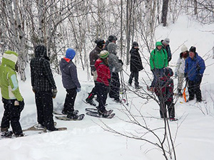 students snowshoeing at Lake Laurentian Conservation Area during our Winter Programming for Schools